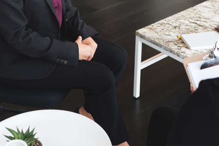 business woman sits for job interview Stock Photo