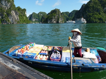 Seller on her boat in Halong Bay, Vietnam