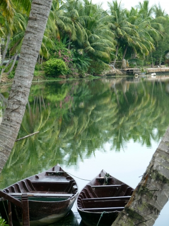conical hat: Peaceful river in Hoi An, Vietnam