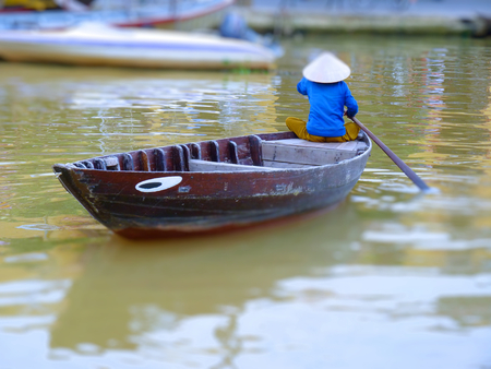 conical hat: Tilt Shift Of A Woman On Her Boat in Hoi An, Vietnam