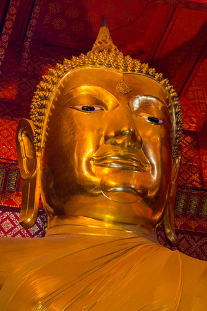 Golden Buddha statue at Wat Phanan Choeng Worawihan, Ayutthaya, Thailand