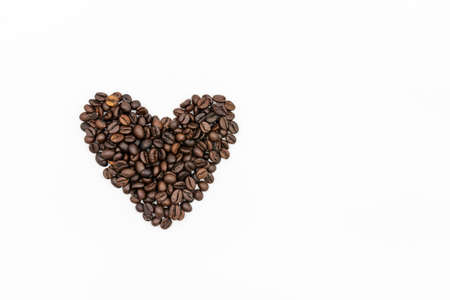 Coffee beans heart shaped isolated on white background
