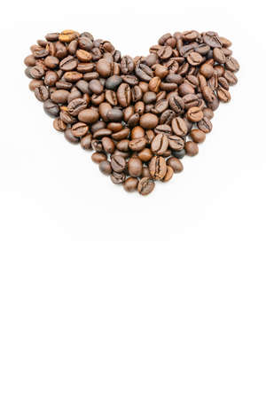 Coffee beans heart shaped isolated on white background Reklamní fotografie