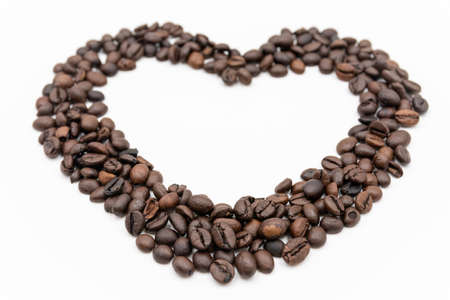 Coffee beans heart frame isolated on white background
