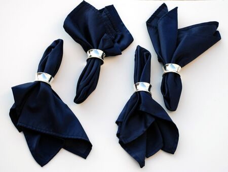 Deep blue cloth napkins in silver rings