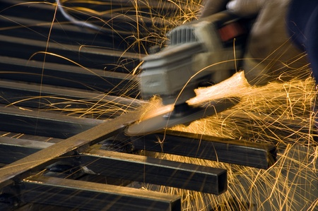 cutting metal with a grinding machine photo