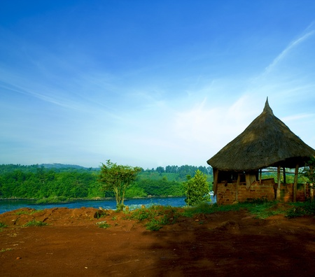 hut on the shore of the nile river photo