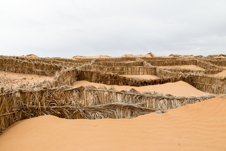 contain: Sand traps in the desert in Morocco. Nobody Stock Photo