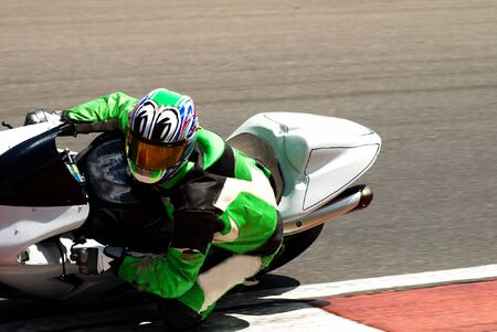 superbike: Close-up of a biker on superbike on track in South Africa. Editorial use only.
