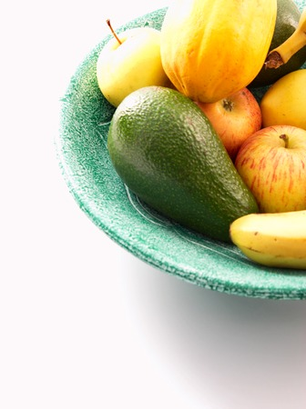 bannana: Green bowl of fresh fruit on a white background Stock Photo