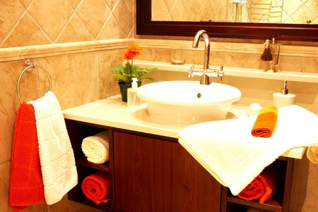 Beautiful sink in a bathroom with towel on it and a flower Stock Photo - 2205381