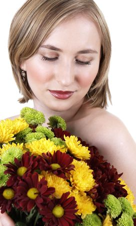 20 25: Beautiful young blonde woman with natural makeup holding a bouquet of flowers