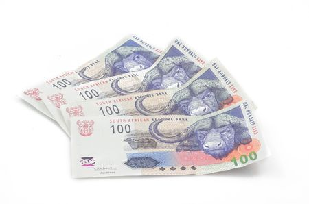 waste money: South African one hundred notes spread out. White background.