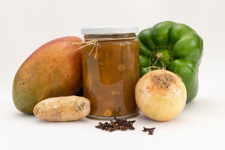 Mango, Chili, Brown Sugar, Ginger, Clove and Cinnamon, Mango Chutney Ingredients. Chutney in the glass.