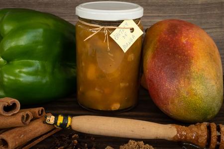Mango, Honey, Chili, Brown Sugar, Ginger, Clove and Cinnamon, Mango Chutney Ingredients. Chutney in the glass. Stock Photo