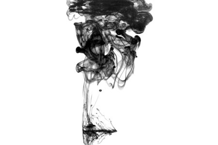 Black color drop in water photographed in motion. Cloud of red ink in water isolated on white. Abstract background.