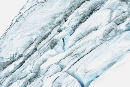 Blue glacier as background in swiss Alps. Top view. Global warming and climate change concept. Stock Photo