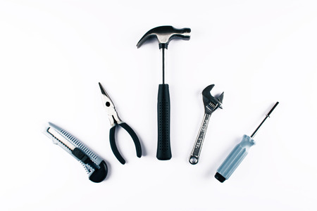 Set of various tools on white background. Construction and renovation concept with copy space. Flat lay style.