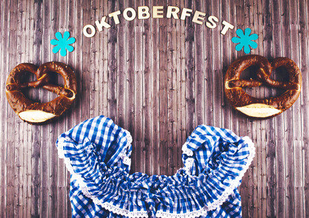 Oktoberfest beer festival on rustic background. Flat lay style. Stock Photo