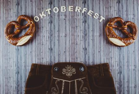 pretzel: Oktoberfest beer festival background on wooden table. Flat lay style. Stock Photo