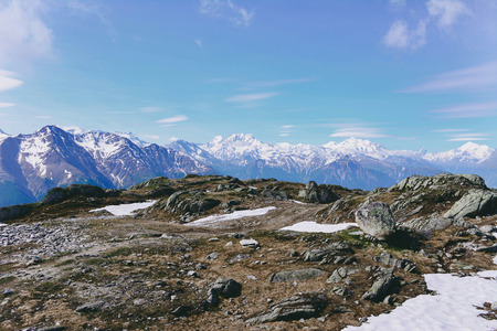 View of beautiful landscape in the Alps with snow-capped mountain tops. Stock Photo