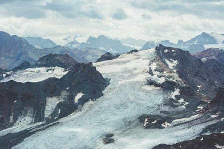 View of beautiful landscape in the Alps with snow-capped mountain tops. Imagens