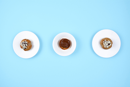 Delicious various pastries on trendy blue background. Flat lay style.