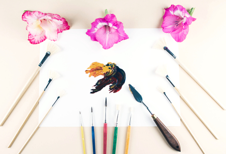 Multicolor oil paint brush strokes with knife on white background. Flat lay style. Art and  education concept.
