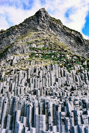 Reynisdrangar basalt sea stacks under the mountain reynisfjall near the village Vik in Iceland.