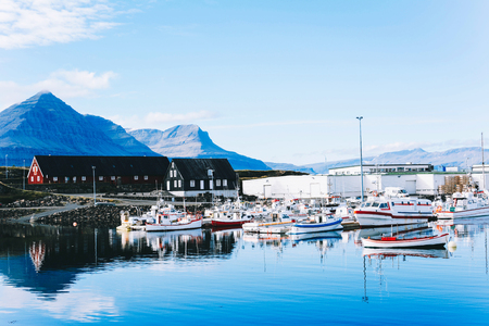 Traditional old fisherman boats in harbor near fishing village in Iceland.