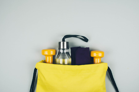 Creative flat lay of sport and fitness equipments with copy space. Foto de archivo