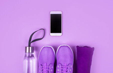 Creative flat lay of sport and fitness equipments on lilac background with copy space. Stock fotó