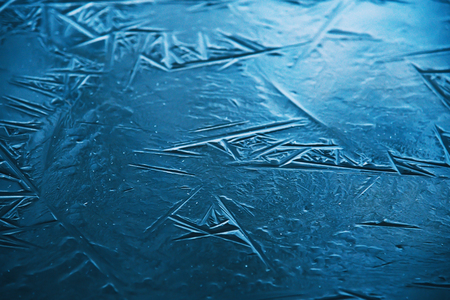 Close up of the ice of a clear frozen lake.