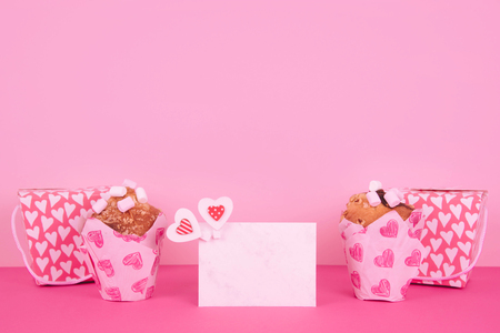 Muffins in colorful paper baking cup with red hearts.