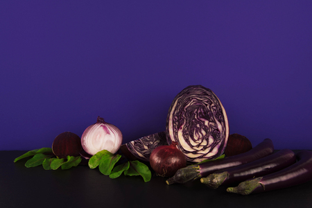 Assortment of raw organic violet vegetables eggplants and red cabbage. Kho ảnh