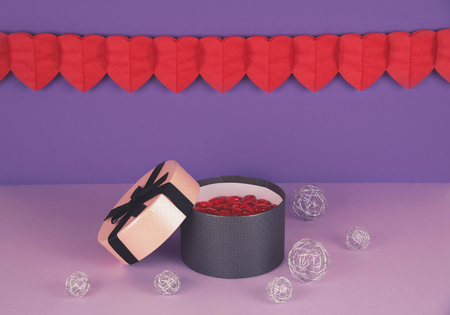 Pink gift box against ultra violet and lilac background with copy space. Valentines day. Kho ảnh