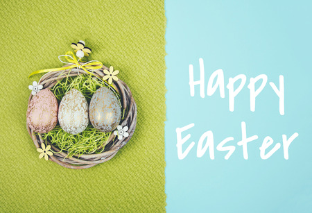 Creative easter composition with painted eggs on green and blue background. Kho ảnh