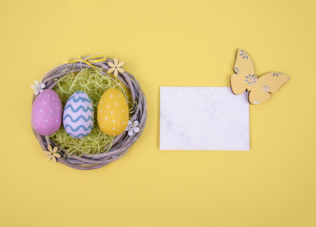 Creative easter composition with painted eggs. Standard-Bild