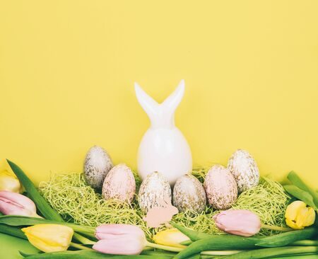 Easter composition with painted eggs and easter bunny