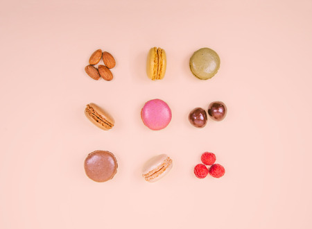 Colorful macaroons on the pink background.