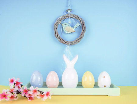Creative easter composition with painted eggs and easter bunny.