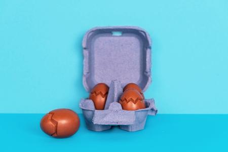 Chocolate eggs on blue background. Standard-Bild