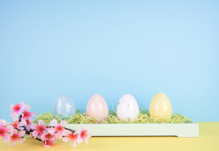 Creative easter composition with painted eggs. Stock Photo