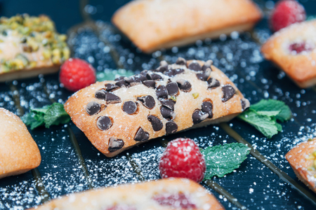 Vegan cakes decorated with mint and berries. Stock Photo