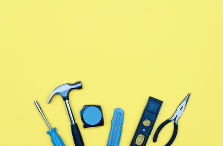 Set of tools. Home improvement concept on yellow background. Stock Photo