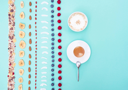 Breakfast with berries and nuts on mint background, copy space. Stock Photo