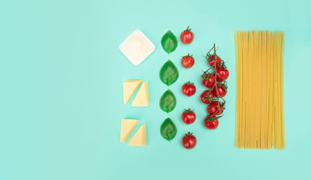 Italian pasta with tomatoes, grated parmesan and basil.