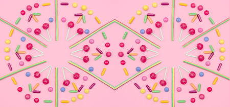 Assorted colored candies pattern on pink background. Stock Photo