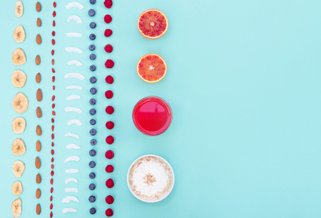 Breakfast with berries and nuts on mint background, copy space. Kho ảnh