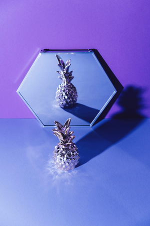 Tropical golden Pineapple on ultraviolet background.
